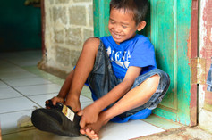YE Outreach Programme student receives shoes
