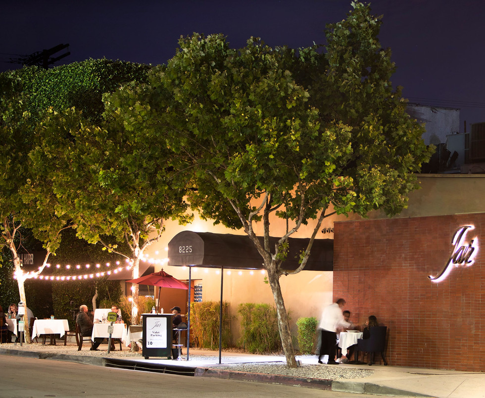Photo of an exterior night view of Jar's patio dining.