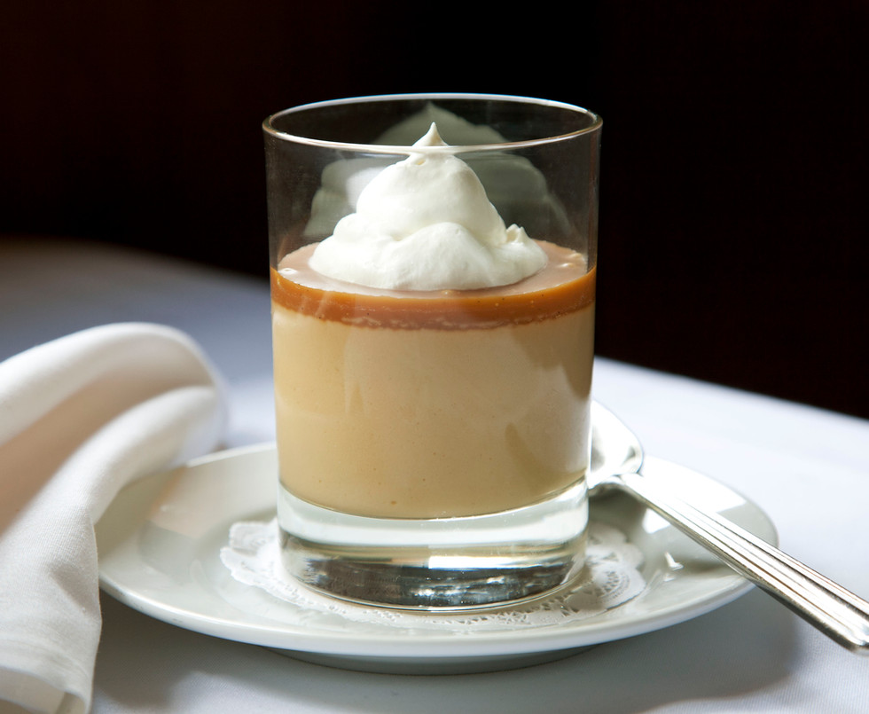 Photo of Butterscotch Pudding served in a glass.