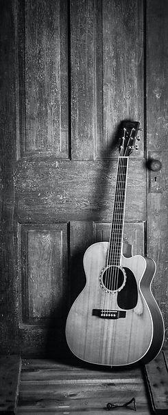 brown-and-black-cut-away-acoustic-guitar