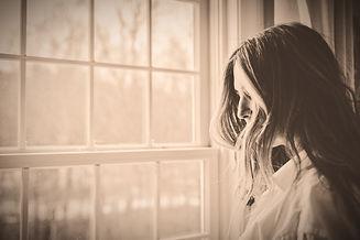 grayscale%20photo%20of%20woman%20near%20window_edited.jpg