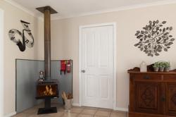 Jacaranda_Cottages_Maleny_Holiday_House_Fire_Pplace