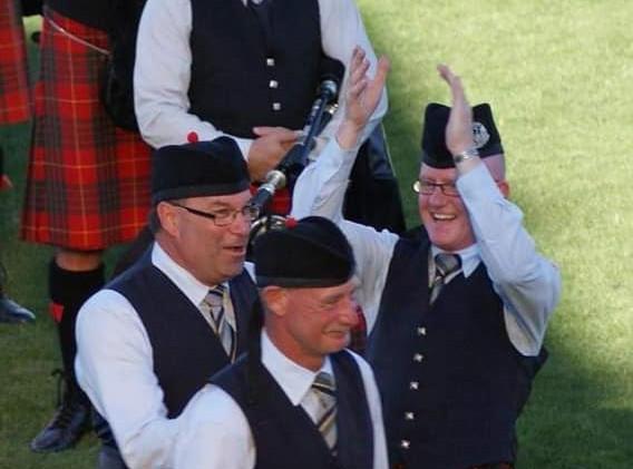 Happy NorthCal members David Schultz, Neil Mogey and former Pipe Major Bain McGregor