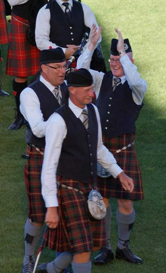 Happy NorthCal members David Schultz, Neil Mogey and former Pipe Major Bain McGregor