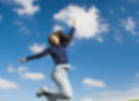 Happy hypnotherapy client jumping to Sydney the sky
