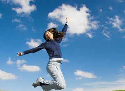 Happy woman flying in the sky -no fear of flying