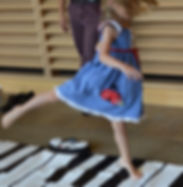 dancing floor piano girl.jpg