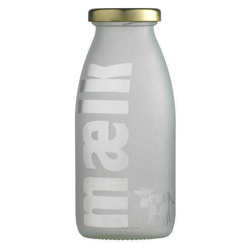 Håndlavet flaske dekoreret med dressing og salatbestik. Flasken er designet af P