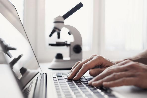Scientist or student using  laptop compu