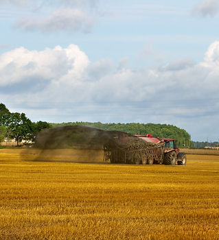 Tractor with  liquid manure on the field
