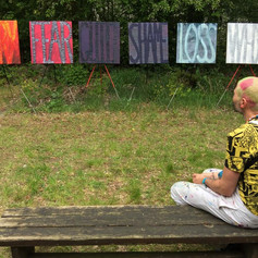 The artist posing with Series of Big words