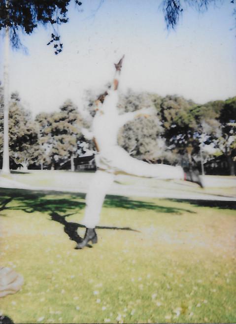 Jenna Leaping in a Field.jpg