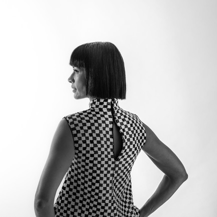 This is our director's take on the roaring twenties - a sleek black bob that is both stylish and functional.