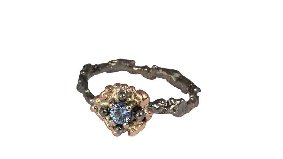 Aurora gold ring with blue Aquamarine