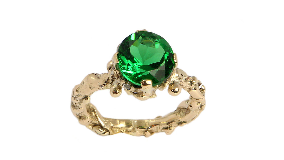 Royal ring with Moldavite stone and diamonds