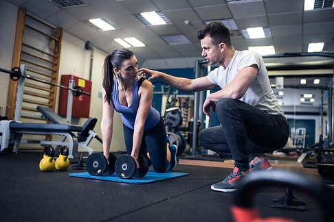 A personal trainer with a client
