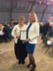Maria Davey receives her Unsung Hero award