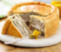 Cambridge picnic pie. light crisp pastry surrounding a herbed sasage meat stuffing with layeed roasted chicked