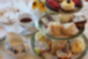 mini chilled cheesecake, fresh fruit tarts, buttery warm scones, mini yorkshire puddings filled wit fillet beef and horseraddish yorkshire tea. perection on three tiers