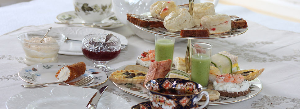 A feast for the eyes and the taste buds. cream filled brandy snaps, Cheese and herb tarletts, minted pea veloute, prawn and ream cheese on rye bread circles, roast beef and horseraddish wraps