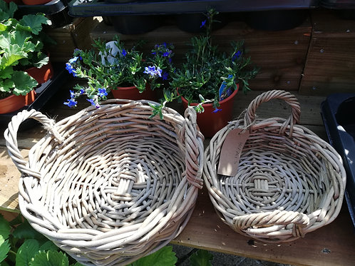 Low round basket with ears