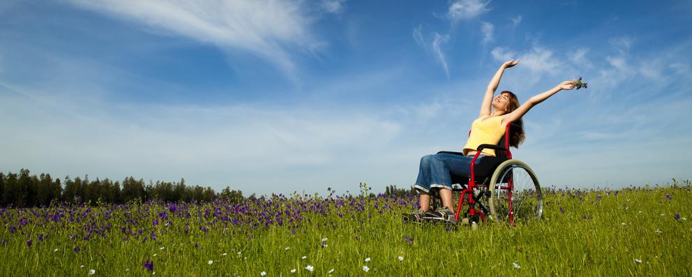 woman in wheelchair in field.jpg