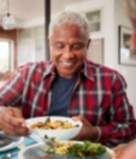 Senior Couple Enjoying Meal Around Table