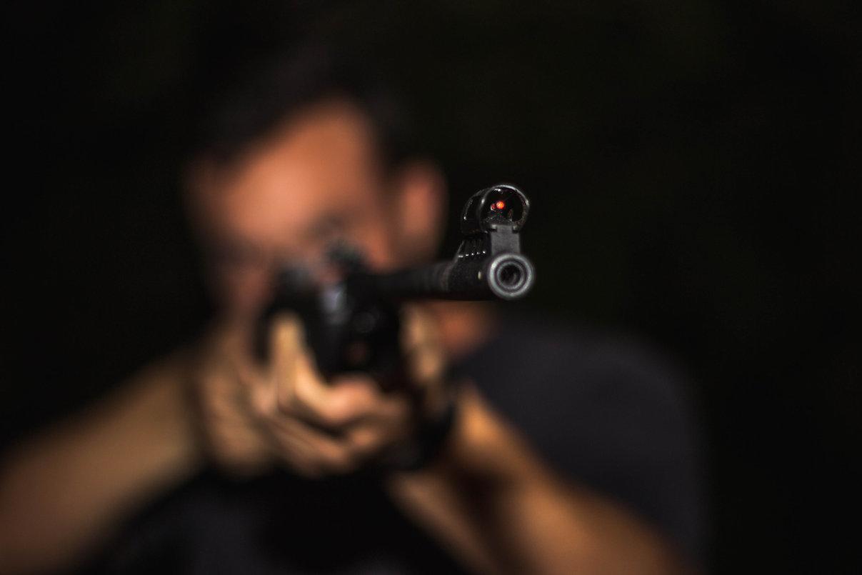 photo-of-man-holding-rifle-1592109.jpg