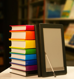 bigstock-Stack-Of-Books-With-Electronic-25376372.jpg