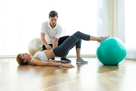 physiotherapist-helping-patient-to-do-ex
