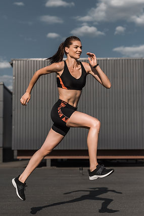 young-athletic-runner-training-in-city-86XXNQR.jpg