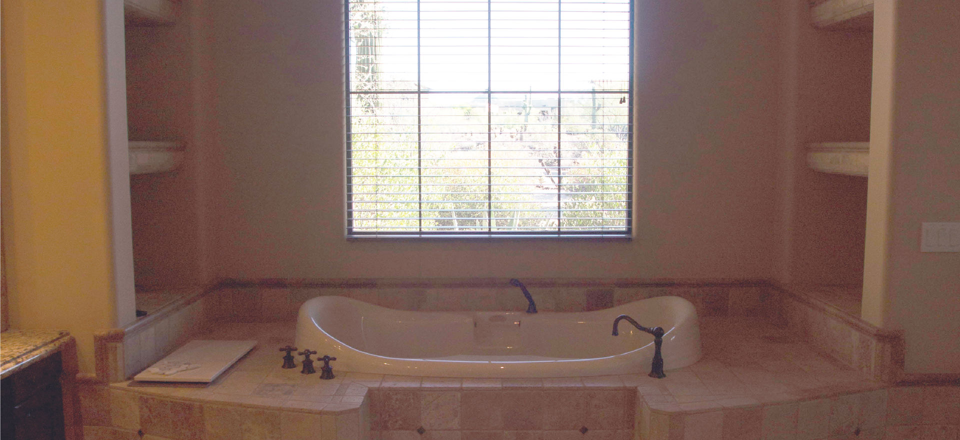Removed the tub, surround and built ins on either side.