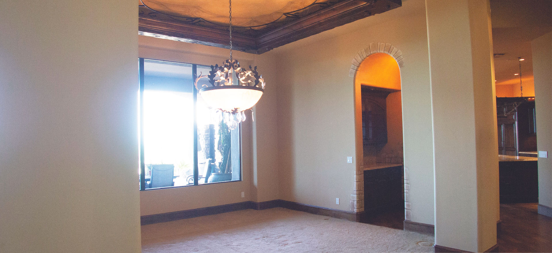 The original dining room and pass through entrance to the wine room.  We removed some of the Tuscan ceiling detail and created an entirely new wine room experience.