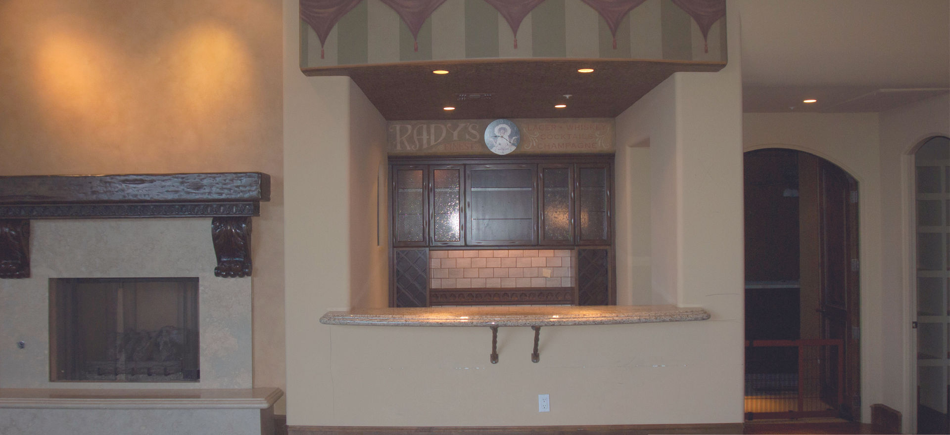 Removing the rounded header was an simple and easy way to bring the look more modern and timeless. New finishes and updated lighting were used to complete the new look.