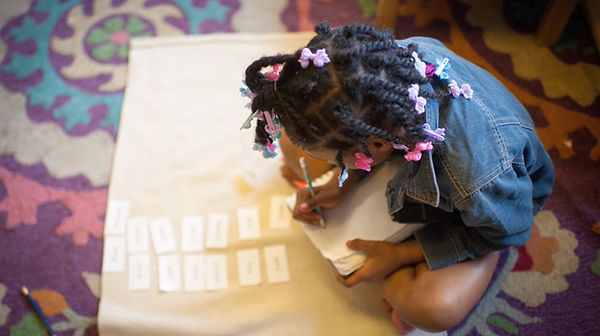 a Montessori student at work with flash cards