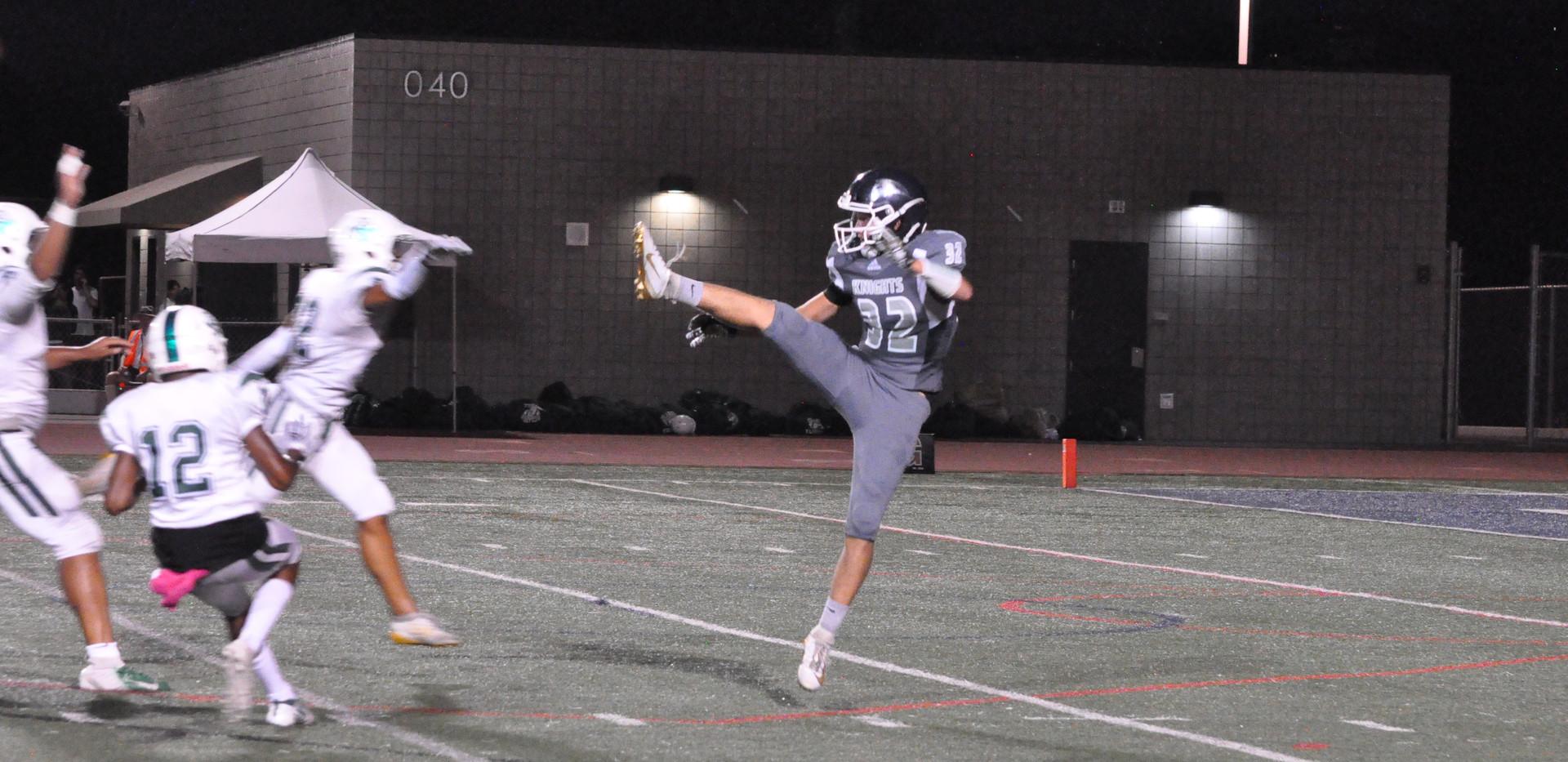 32 kicking ball high leg.JPG