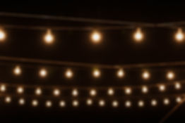 Garlands of lamps on a wooden stand on t