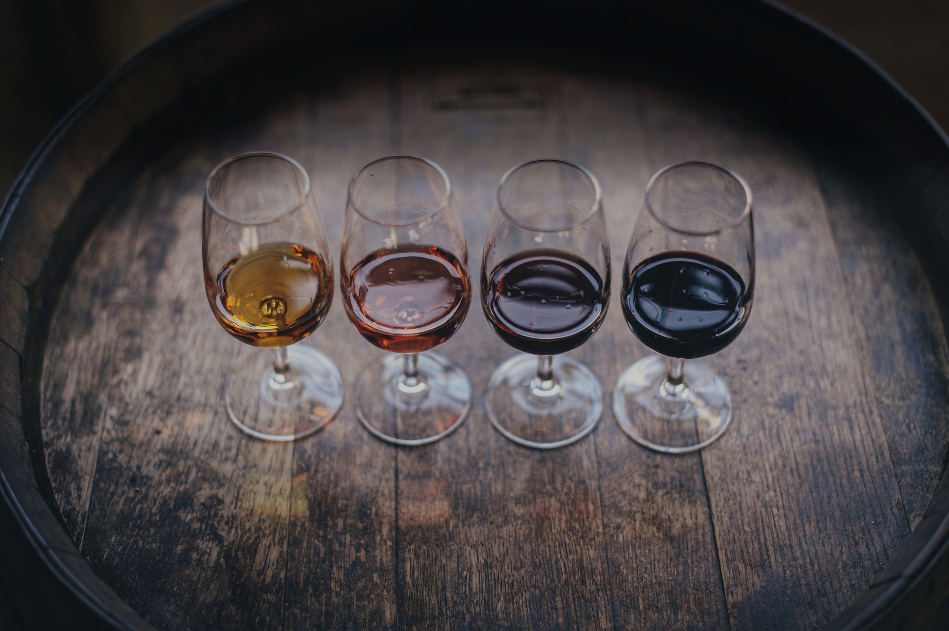 Four glasses of mead ranging from a traditional golden mead to a dark red fruity melomel mead. Buy Mead online from Elgin Meadery.