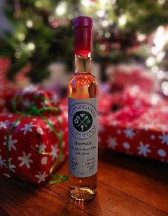 A bottle of Aromatis mead from Elgin Meadery. Spiced mead aged in oak barrels.