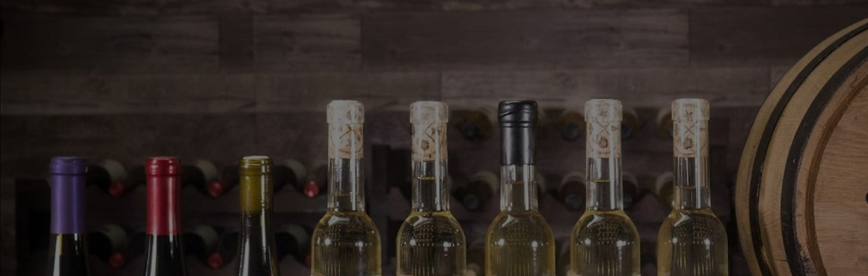This banner image displays the corked tops of mead bottles and an aging barrel.