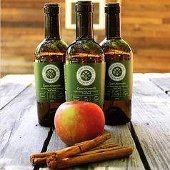 Three bottles of Cyser Aaromatis, apple cinnamon melomel mead.