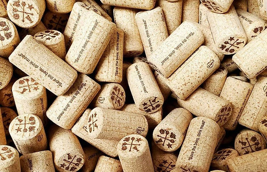A pile of mead corks that say 'save the bees drink mead.'