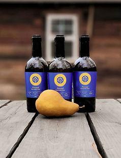 Three bottles of Pirumel, a pear honey mead from Eglin Meadery