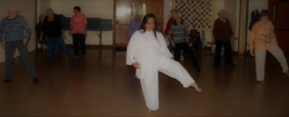 tai chi instructor leading class