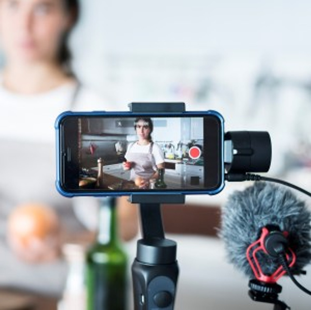 Woman videoing her own content, which might be life history