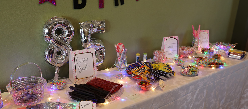 85th birthday balloons, candy buffet with tiny lights