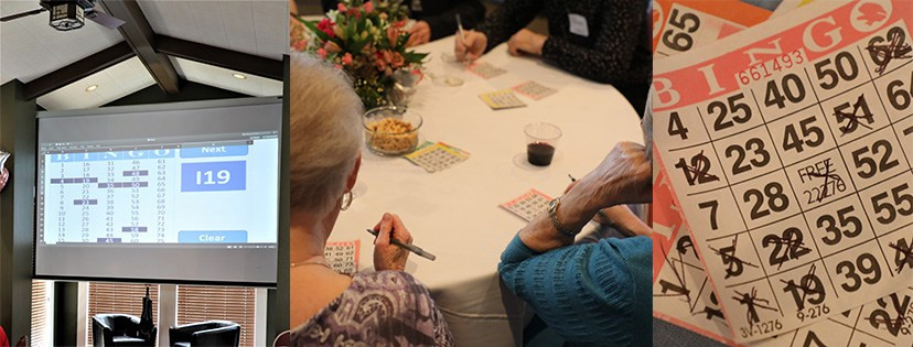 Bingo game projected on screen, players at a table, paper bingo cards with X's