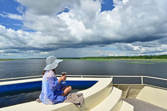 Zambezi Queen pool deck Chobe river.jpg