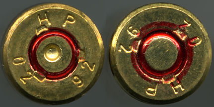 5.56_x_45mm_NATO_cartridge_bottom_-_fire