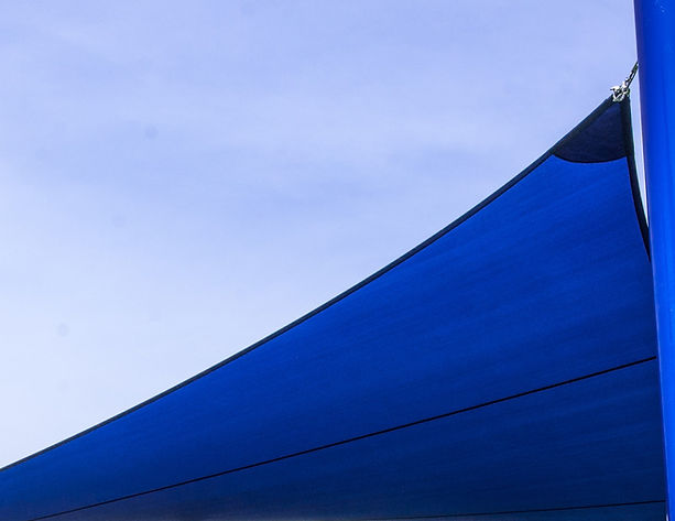 Zoomed in side and corner blue sail